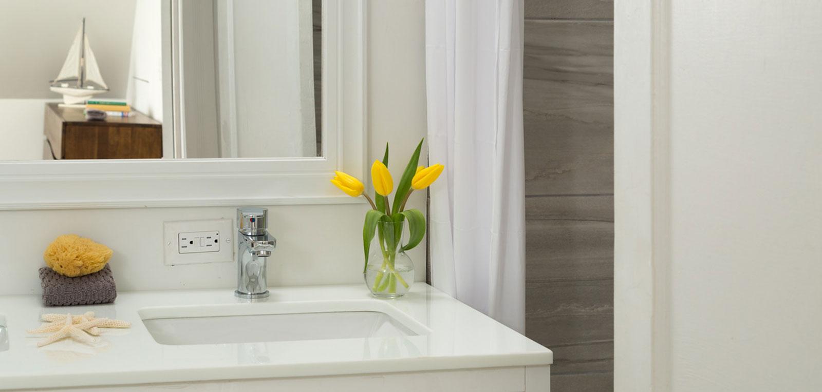 2BR Apartment Bathroom Faucet and Flower | ADMIRAL SIMS B&B, Newport Rhode Island