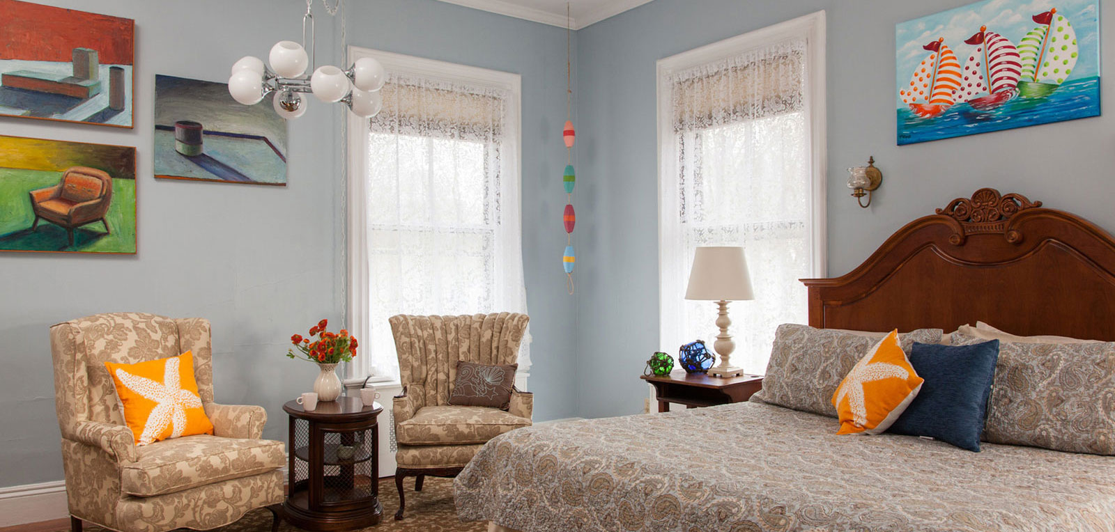 King Private Bath Bedroom Room with Paintings | ADMIRAL SIMS B&B, Newport Rhode Island
